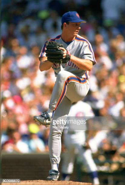 David Cone of the New York Mets pitches during an MLB game versus the Chicago Cubs at Wrigley Field in Chicago Illinois during the 1989 season