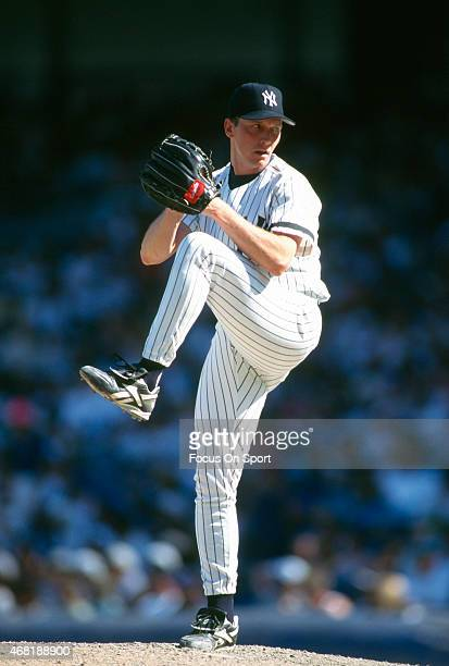 David Cone of the New York Yankees pitches during an Major League Baseball game circa 1995 at Yankee Stadium in the Bronx borough of New York City...