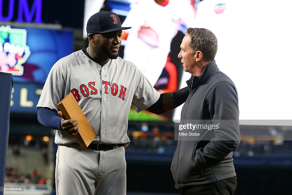David Cone presents a a gift to David Ortiz #34 of the Boston Red Sox during a pregame ceremony at Yankee Stadium on September 29, 2016 in the Bronx borough of New York City. Yankees defeated the Red Sox 5-1