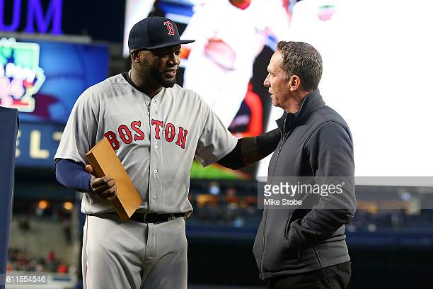 David Cone presents a a gift to David Ortiz of the Boston Red Sox during a pregame ceremony at Yankee Stadium on September 29 2016 in the Bronx...