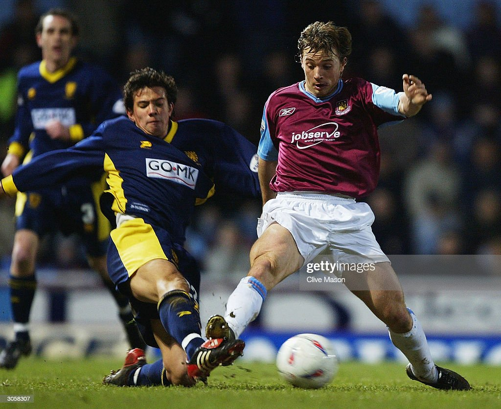 David Connolly of West Ham is challenged by Rob Gier of Wimbledon during the Nationwide Division One match between West Ham United and Wimbledon at Upton Park on March 9, 2004 in London.