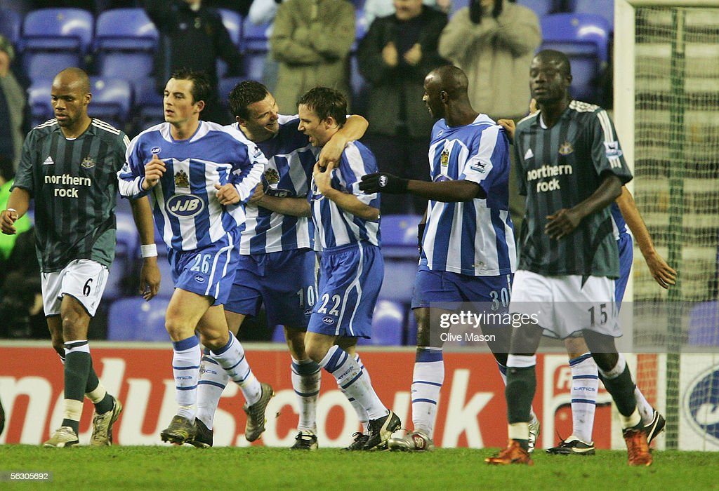 David Connolly (22) of Wigan Athletic celebrates his goal during the Carling Cup, fourth round match between Wigan Athletic and Newcastle United at the JJB Stadium on November 30, 2005 in Wigan, England.