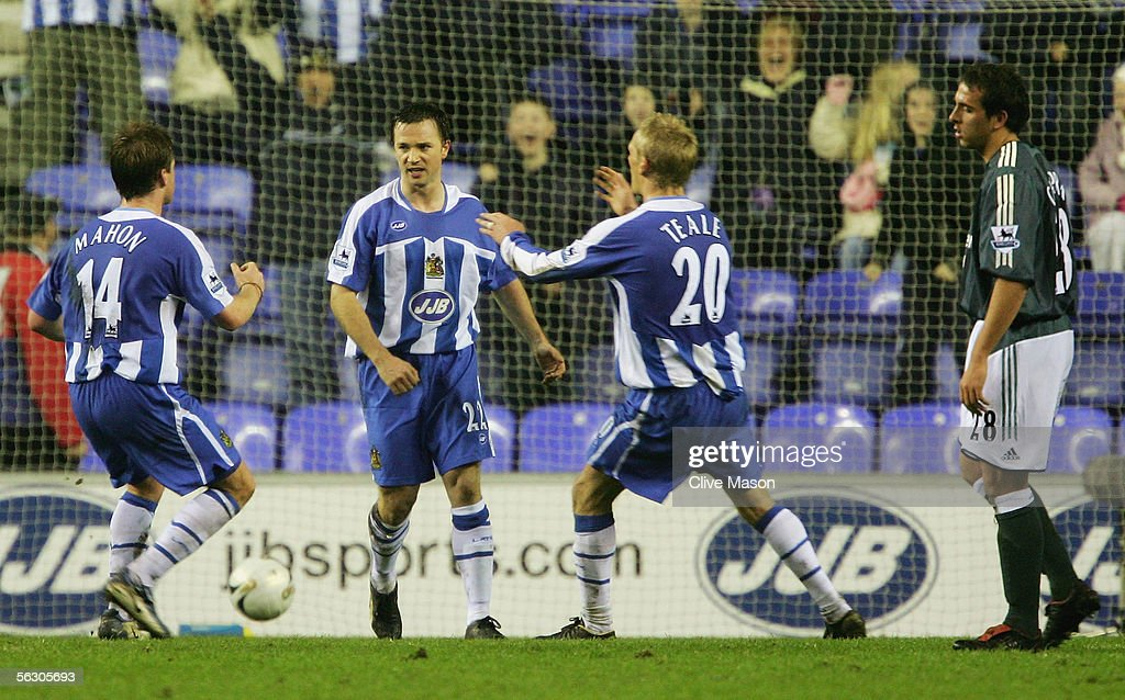 David Connolly (C) of Wigan Athletic celebrates his goal during the Carling Cup, fourth round match between Wigan Athletic and Newcastle United at the JJB Stadium on November 30, 2005 in Wigan, England.