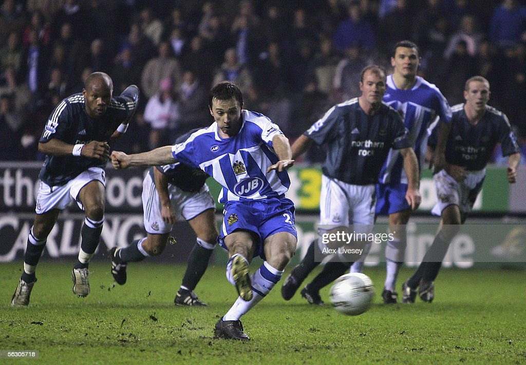 David Connolly of Wigan Athletic scores the winning goal from the penalty spot during the Carling Cup fourth round match between Wigan Athletic and Newcastle United at the JJB Stadium on November 30, 2005 in Wigan, England