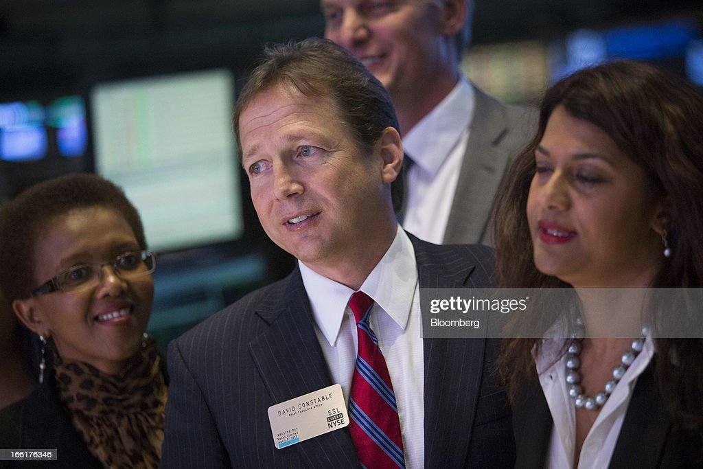 David Constable, chief executive officer of Sasol Ltd., center, watches trading before the closing bell at the New York Stock Exchange (NYSE) in New York, U.S., on Tuesday, April 9, 2013. U.S. stocks rose, sending benchmark indexes toward record closing highs, on optimism over corporate earnings and as commodities gained amid a report showing China's inflation slowed. Photographer: Scott Eells/Bloomberg via Getty Images