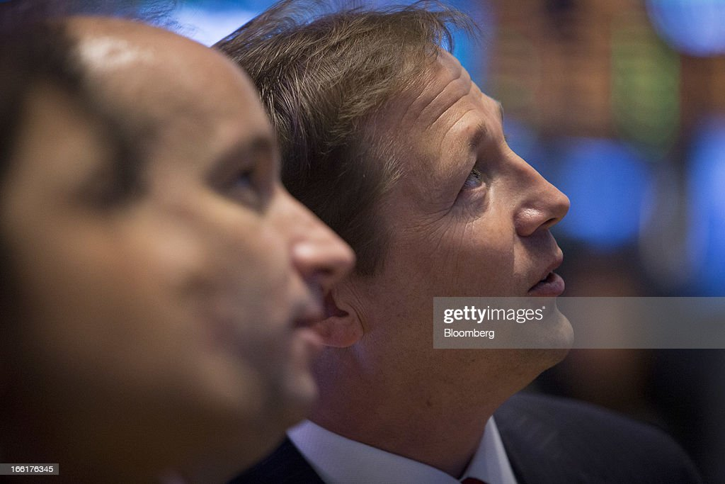 David Constable, chief executive officer of Sasol Ltd., right, watches trading before the closing bell at the New York Stock Exchange (NYSE) in New York, U.S., on Tuesday, April 9, 2013. U.S. stocks rose, sending benchmark indexes toward record closing highs, on optimism over corporate earnings and as commodities gained amid a report showing China's inflation slowed. Photographer: Scott Eells/Bloomberg via Getty Images