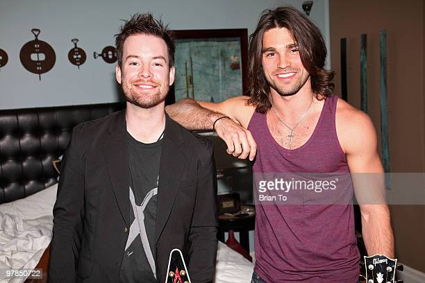 David Cook and Justin Gaston pose for a photo at the If I Can Dream house on March 18 2010 in Los Angeles California