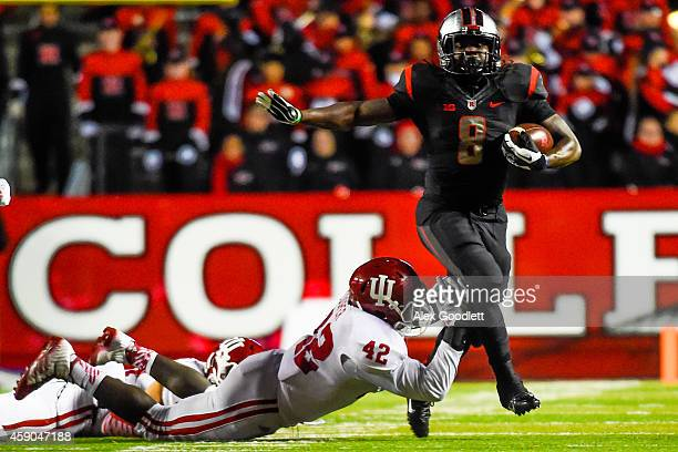 David Cooper of the Indiana Hoosiers attempts to tackle Josh Hicks of the Rutgers Scarlet Knights in the third quarter at High Point Solutions...
