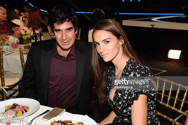 David Copperfield and Chloe Gosselin attend the Billboard Women in Music 2016 event on December 9 2016 in New York City
