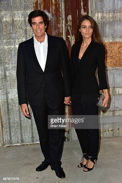 David Copperfield and Chloe Gosselin attend the Givenchy show during Spring 2016 New York Fashion Week at Pier 26 on September 11 2015 in New York...