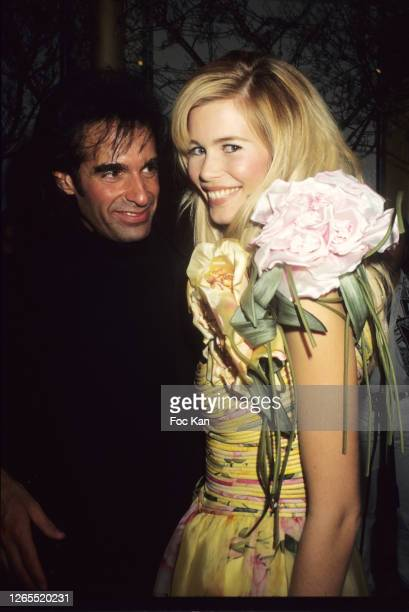 David Copperfield and Claudia Schiffer attend a fashion show during Paris Fashion Week in the 1990s in Paris, France.