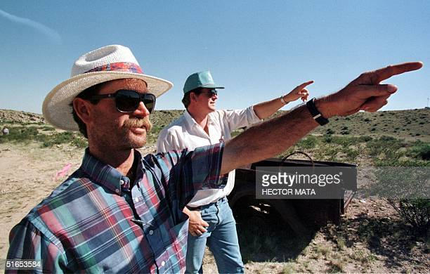 David Corn and his cousin Bill Marley point 02 July toward the direction from where the alleged UFO came before crashing at his ranch 50 years ago in...