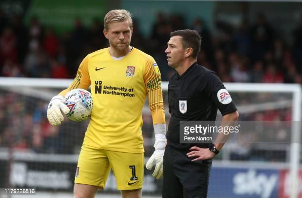David Cornell of Northampton Town and referee Tony Harrington look on during the Sky Bet League Two match between Northampton Town and Leyton Orient...