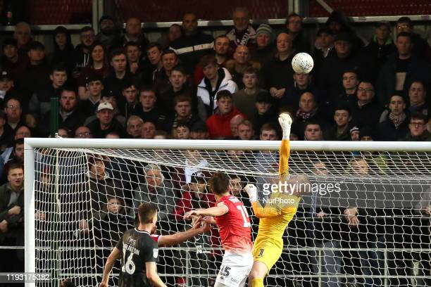 David Cornell of Northampton Town FC punches the ball over the bar during the Sky Bet League 2 match between Salford City and Northampton Town at...