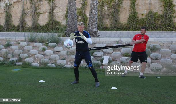 David Cornell of Northampton Town works out with goalkeeper coach Jim Hollman during a training session at Lomas de Campoamor on July 16 2018 in...