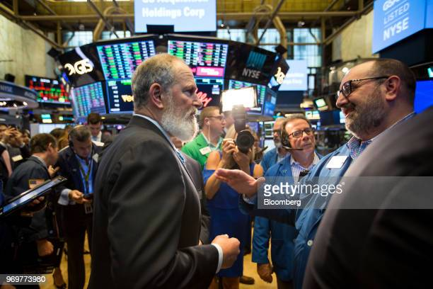 David Cote, chief executive officer of GS Acquisition Holdings Corp., center left, speaks with a trader during the company's initial public offering...