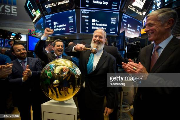 David Cote, chief executive officer of GS Acquisition Holdings Corp., center, rings a ceremonial bell during the company's initial public offering on...