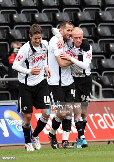 David Cotterill celerates after scoring the opening goal during the CocaCola championship match between Swansea City and Newcastle United at The...
