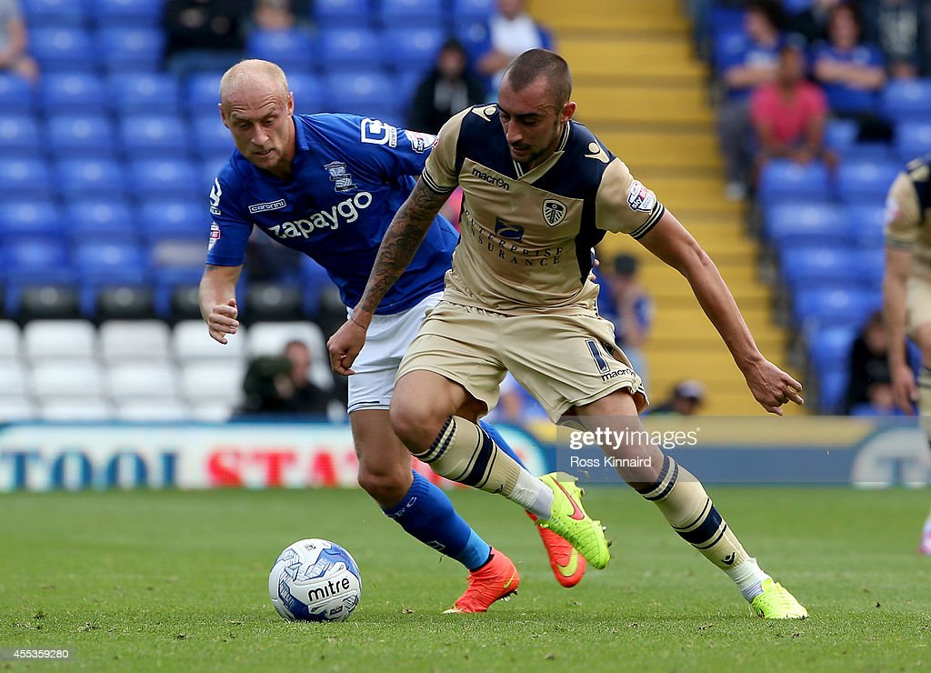 David Cotterill of Birmingham is challenged by Tommaso Bianchi of Leeds during the Sky Bet Championship match between Birmingham City and Leeds United at St Andrews (stadium) on September 13, 2014 in Birmingham, England.