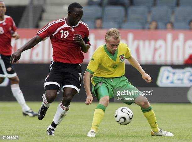 David Cotterill of Wales and Dwight Yorke of Trinidad and Tobago challenge during the friendly match between Wales and Trinidad and Tobago on May 27,...