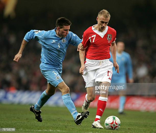 David Cotterill of Wales gets tackled by Matteo Andreini of San Marino during the UEFA Euro 2008 qualifying match between Wales and San Marino at the...
