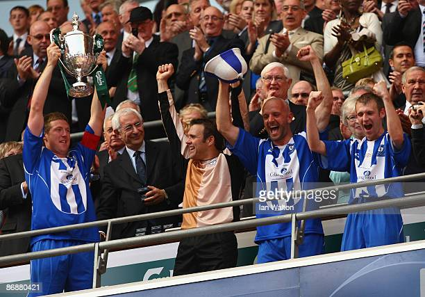 David Coulson of Whitley Bay celebrates with the trophy after winning the FA Vase Final between Glossop North End and Whitley Bay at Wembley Stadium...