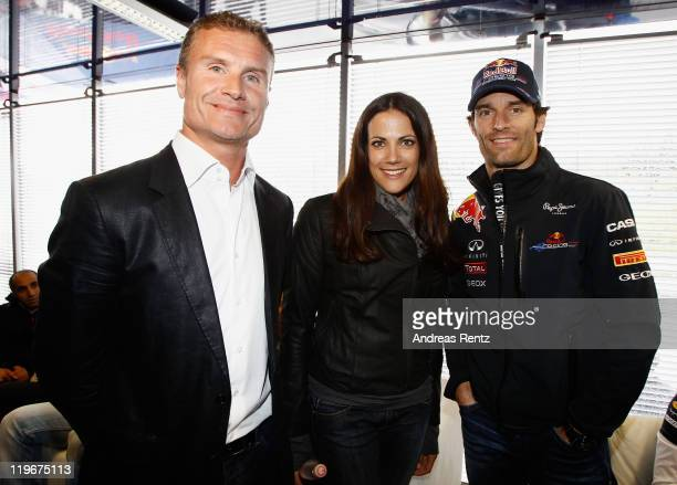 David Coulthard actress Bettina Zimmermann and Mark Webber of Australia and Red Bull Racing attend the Red Bull On Track event at the Driving Safety...