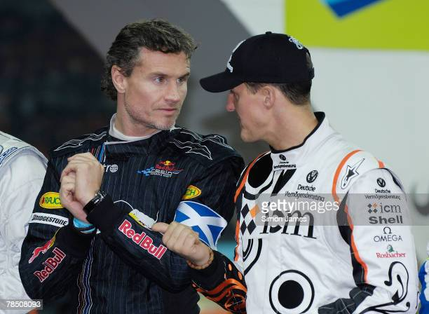 David Coulthard and former Ferrari Formula One World Champion Michael Schumacher during a tribute to the late rally driver Colin McRae at The Race of...
