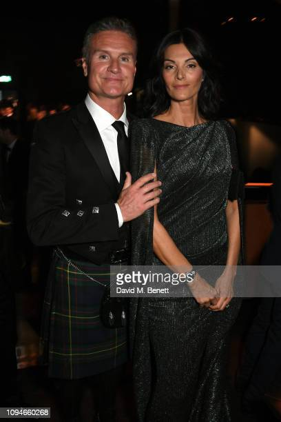 David Coulthard and Karen Minier attend the IWC Schaffhausen Gala celebrating the launch of the new Pilot's Watches at the Salon International de la...
