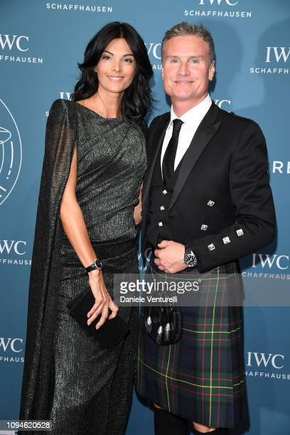 David Coulthard and Karen Minier walk the red carpet for IWC Schaffhausen at SIHH 2019 on January 15 2019 in Geneva Switzerland