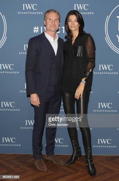 David Coulthard and wife Karen Minier visit the IWC booth during the Maison's launch of its Jubilee Collection at the Salon International de la Haute...