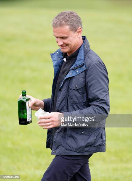 David Coulthard hands out drinks as he attends the 5th edition of the 'ISPS Handa Mike Tindall Celebrity Golf Classic' at The Belfry on May 19 2017...