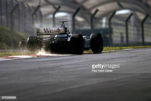 David Coulthard, McLaren-Mercedes MP4/14, Grand Prix of Malaysia, Sepang International Circuit, 17 October 1999. David Coulthard in the grass,...