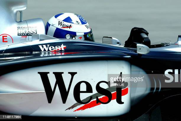 David Coulthard of Britain takes his McLaren into a corner during the first practice session in preparation for this weekend's Malaysian Grand Prix...