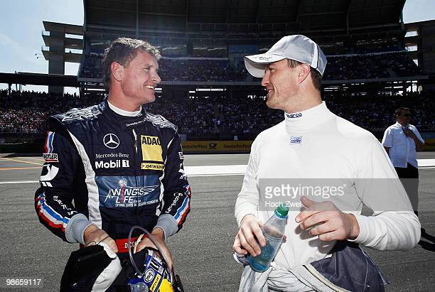 David Coulthard of Great Britain and Mücke Motorsport AMG Mercedes is seen with Ralf Schumacher of Germany and Team HWA AMG Mercedes before they both...