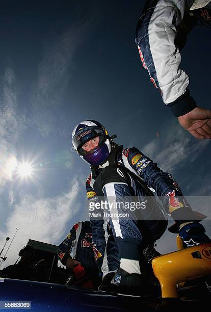 David Coulthard of Great Britain and Red Bull climbs out of his cockpit on the grid prior to the start of the Japan F1 Grand Prix at the Suzuka...