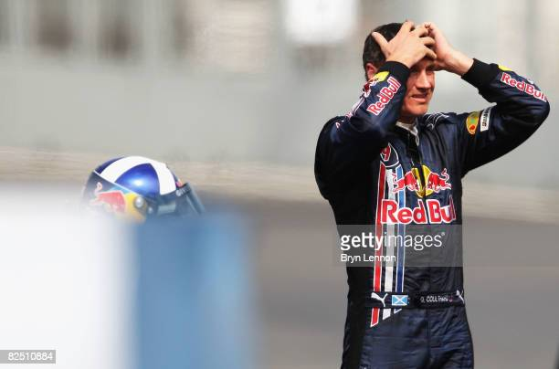 David Coulthard of Great Britain and Red Bull Racing looks on after he crashes during practice for the European Formula One Grand Prix at the...