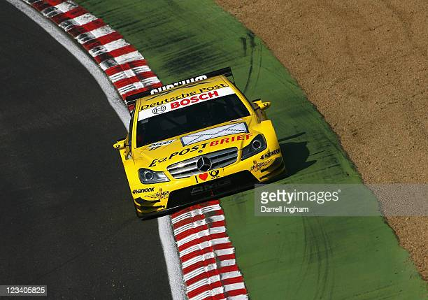 David Coulthard of Great Britain drives the Deutsche Post AMG Mercedes C-Klasse during practice for the DTM German Touring Car Championship race at...