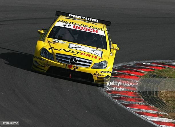 David Coulthard of Great Britain drives the Deutsche Post AMG Mercedes C-Klasseduring practice for the DTM German Touring Car Championship race at...