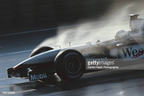 David Coulthard of Great Britain drives the West McLaren Mercedes McLaren MP4/15 Mercedes V10 in the simulated wet during Formula One pre season...