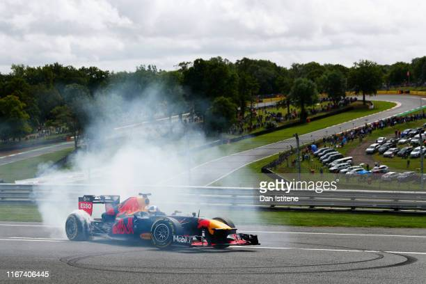 David Coulthard performs donuts during a show run in Red Bull Racing's RB7 ahead of the W Series round six and final race of the inaugural...