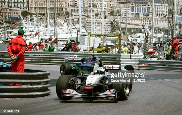 David Coulthard signals to Kimi Raikkonen that he is pulling into the pits during practice in Monaco