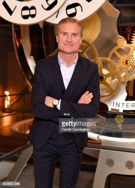David Coulthard visits the IWC booth during the Maison's launch of its Jubilee Collection at the Salon International de la Haute Horlogerie on...