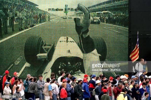David Coulthard's monent of agony as he stalls on the grid is flashed up on the video screens at the circuit at the start of the Spanish Grand Prix