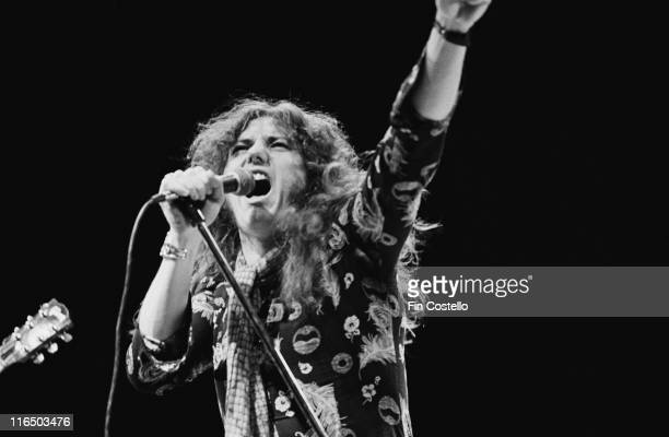 David Coverdale British singer with heavy rock band Whitesnake singing into a microphone on the set of a video shoot at Shepperton Studios outside...