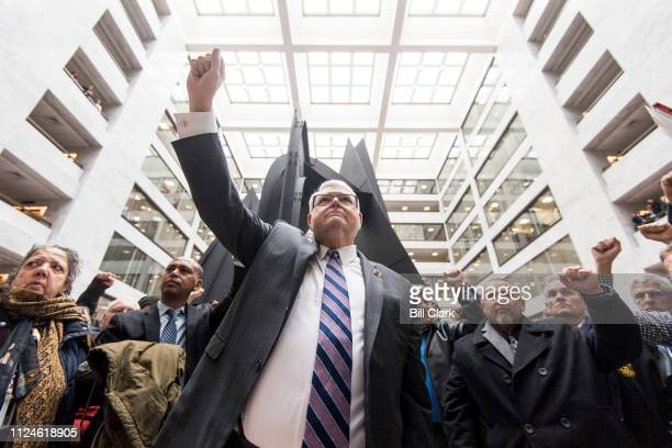 J David Cox Sr president of the American Federation of Government Employees holds up his fist as federal workers hold a sildent protest for 35...