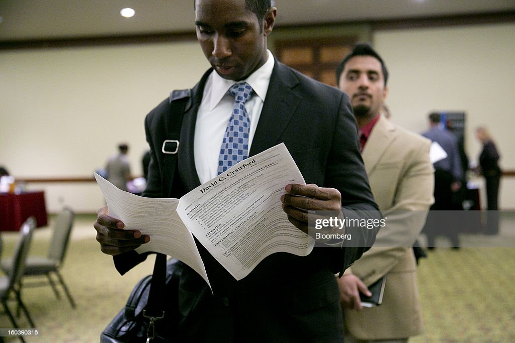 David Crawford looks at his resume while waiting in line to speak to a job recruiter at a National Career Fairs job fair in Arlington, Virginia, U.S., on Wednesday, Jan. 30, 2013. The U.S. Labor Department is scheduled to release initial jobless claims data on Jan. 31. Photographer: Andrew Harrer/Bloomberg via Getty Images