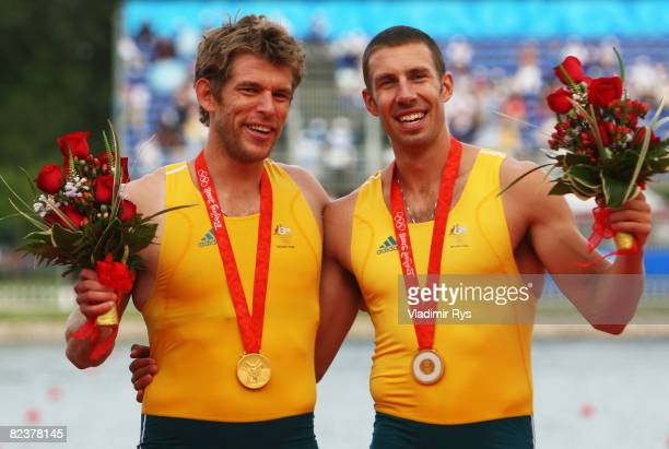 David Crawshay and Scott Brennan of Australia celebrate the gold medal in the Men's Double Sculls Final at the Shunyi Olympic RowingCanoeing Park on...