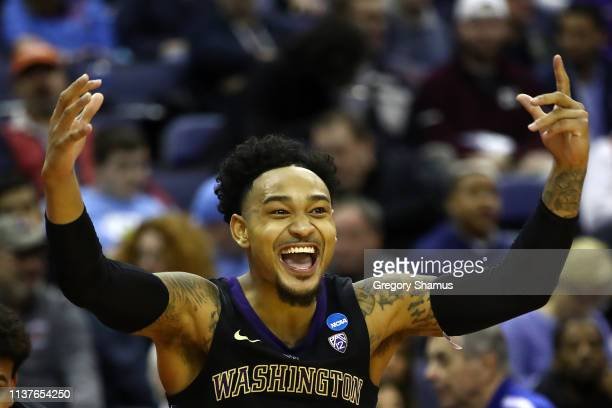 David Crisp of the Washington Huskies celebrates their 7861 win over the Utah State Aggies in the first round of the 2019 NCAA Men's Basketball...