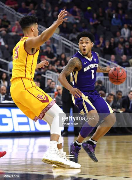 David Crisp of the Washington Huskies drives against Bennie Boatwright of the USC Trojans during a firstround game of the Pac12 Basketball Tournament...